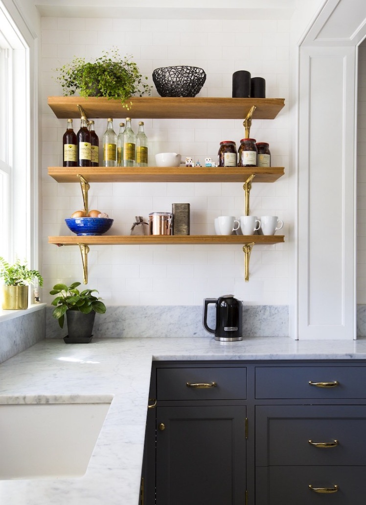 white countertops with navy cabinets and gold hardware kitchen style inspirations