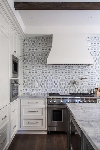 patterned tile kitchen backsplash with white cabinets and countertops kitchen style inspirations
