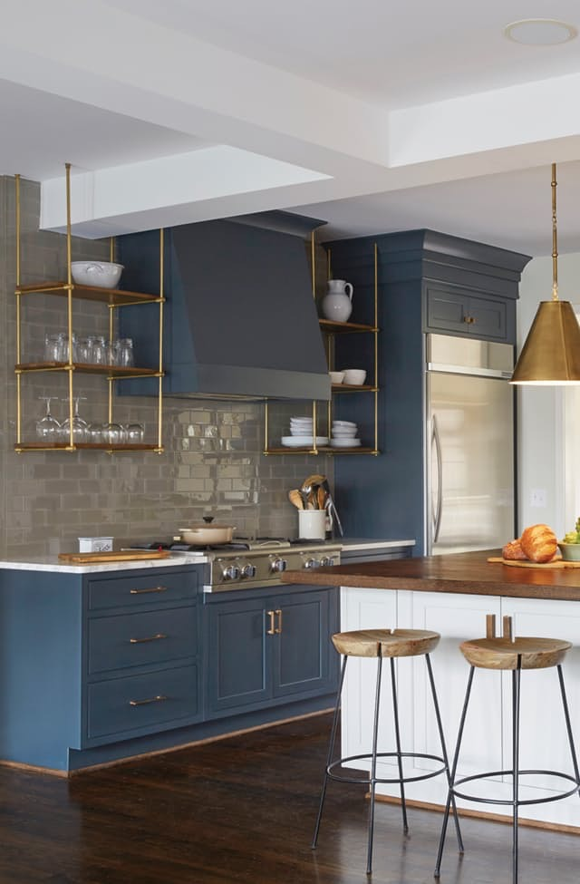 navy cabinets  and gold hardware  kitchen style inspirations